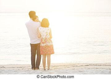 Family enjoying holiday vacation on beach
