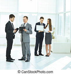 successful business team before a  meeting in the lobby