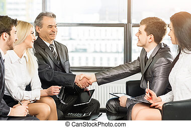 group of businessmen discussing the policies the company...
