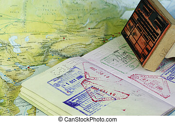 Visa Stamps - visa stamps on a passport indicting travel...