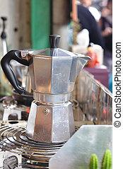 Classic Italian coffee pot boiling on stove