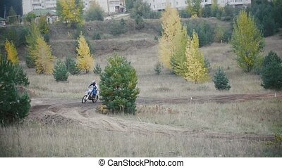 Motocross racer on dirt bike on track in rapid shoot, Slow...