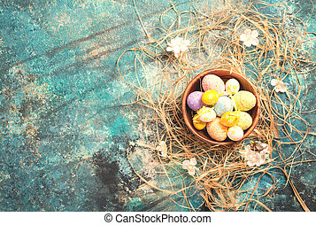 easter decoration with colored eggs over blue background....