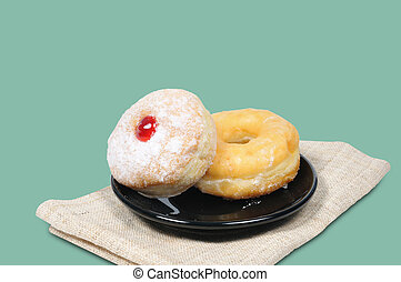 Donut in black plate on napkin