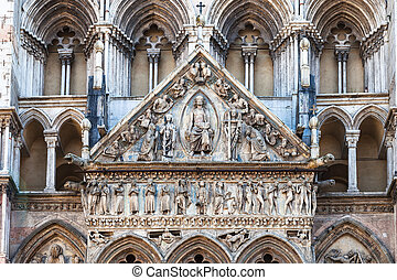 decoration of facade of Ferrara Cathedral - travel to Italy...