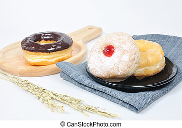 Donut in black plate on napkin