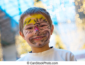 Cheerful boy with makeup on his face
