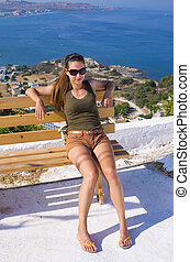 Young woman sitting on the bench, Rhodes, Greece - Young...