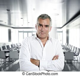 gray hair businessman interior white office - senior...