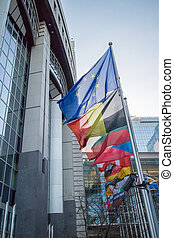 Flags with European Parliament in Brussels, Belgium
