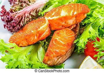 fried salmon, Lettuce Lollo rossa, lemon wedges, cherry...
