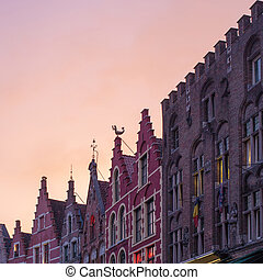 buildings in the Market Square in sunset in Bruges, natural...
