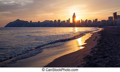 Golden sunset on the Poniente beach in Benidorm