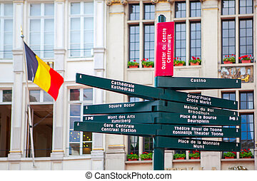 traditional directional signs for tourists in center of...