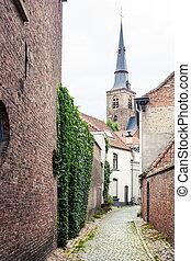 Old street in Bruges, Belgium - medieval buildings houses in...