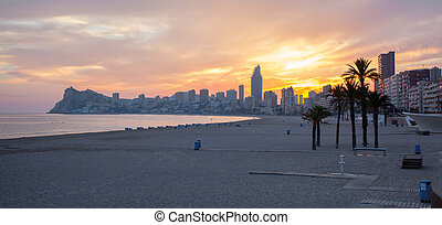 Sunset on Benidorm beach with its island in the background,...