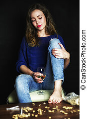 Pretty sad girl with glass of wine - Dissapointed woman...