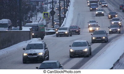 Cars on road in winter - Cars on winter road in city
