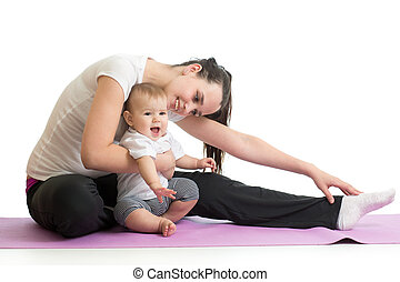Young woman mother doing fitness exercises with baby, studio portrait isolated on white background