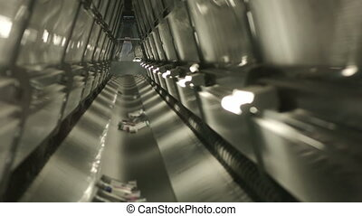 Medications move inside conveyor belt in the warehouse of...