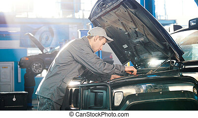 Mechanic in car service - repairing for luxury SUV