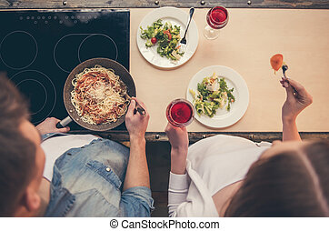 Beautiful couple cooking - Top view of beautiful couple...