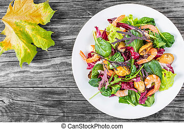 fresh salad of prawns, mussels and mixed lettuce leaves, top...