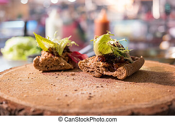 Bacon and onion jam sandwiches. Lettuce and duck meat. Light...