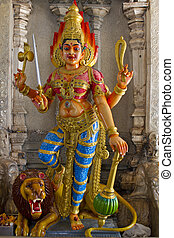 Hindu Goddess Durga on Lion with Trident in Temple