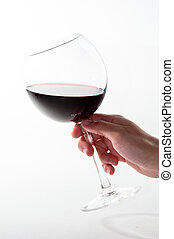 Wine Glass - Female hand holding red wine glass over white...