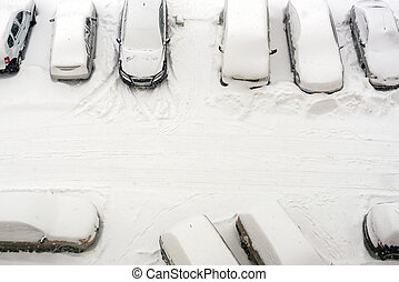 elevated view of snow covered cars in parking lot - elevated...