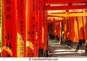 Wooden Torii Gates near Kyoto, Japan - Wooden Torii Gates at...