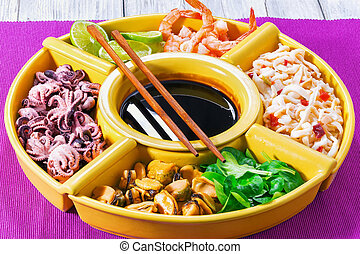 seafood set of prawns, octopus, mussels, squid rings with...