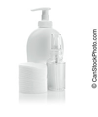 white cosmetical bottles and pads