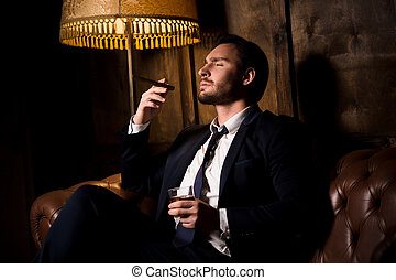 Rich businessman with cigar - Handsome man drinking whiskey...