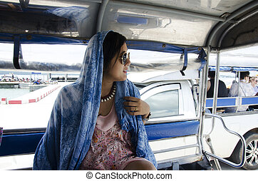 Asian traveler woman sit on pick up car for tour around Koh...