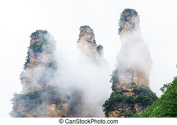 Beautiful Rock Mountains with Green Trees Surrounded by...