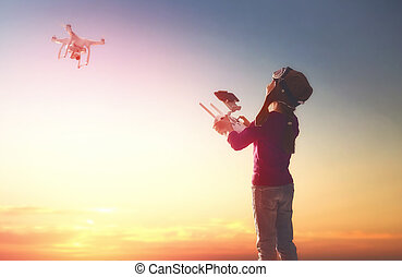 Kid is playing with drone - Little girl is operating the...