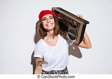 Young lady holding tape recorder. - Photo of young lady...