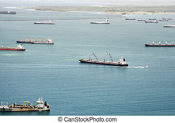Aerial view of large cargo ships waiting at Gatun Lake to...