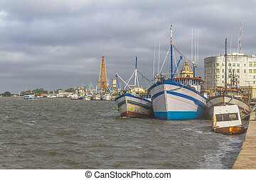 Boats anchored in Lagoa do Patos lake - Boats anchored with...