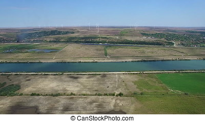 Aerial view of Danube river and windmills