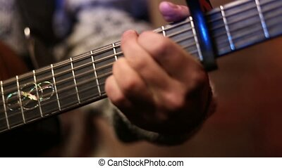 Man playing acoustic guitar close up - Closeup male hand...