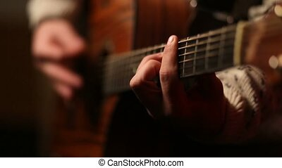 Cool guy with hat playing guitar on stage - Young handsome...