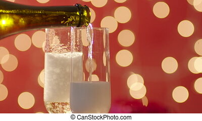 Wedding rings and two glasses filled with champagne with...