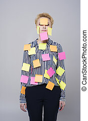 Multi tasking woman with colorful papers