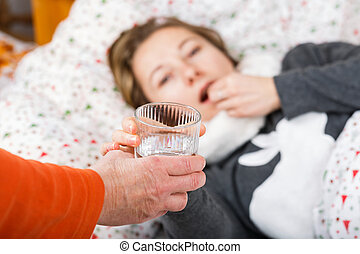 Sick woman getting flu - Sick young woman resting in the bed