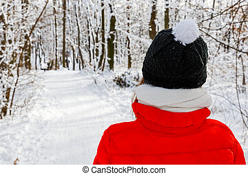 Woodland walk in wintertime - Photo of young woman walking...
