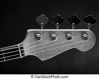 Electric bass guitar headstock - Black and white photo of a...
