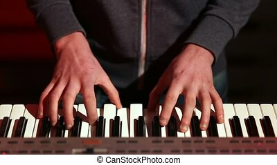 Man hands playing electronic keyboard on stage - Frontal...